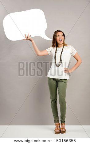 Beautiful woman holding a speech bubble