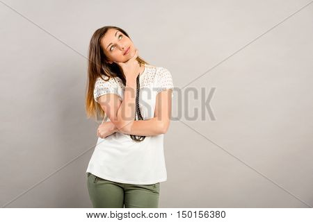 Beautiful and lovely girl making a thinking expression