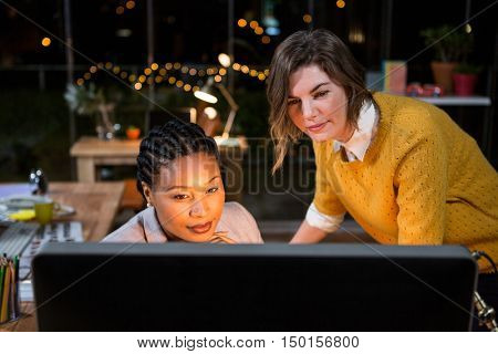 Women looking at computer in the office