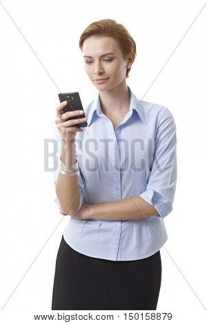 Pretty young businesswoman using mobilephone.