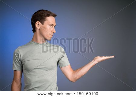 Man holding something on his palm.