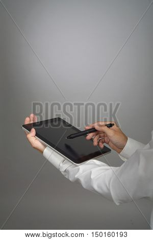 Man in the white shirt works with tablet PC