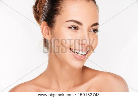 Beauty portrait of a happy woman with skincare standing isolated on a white background