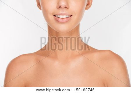 Cropped image of a woman with skin care looking at camera isolated on a white background