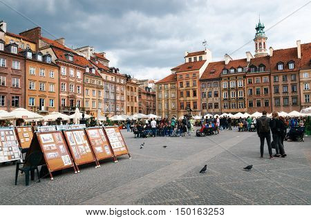 Warsaw Poland - May 28 2015: Paintings and pictures art for sale on the Old Town Market Place square.