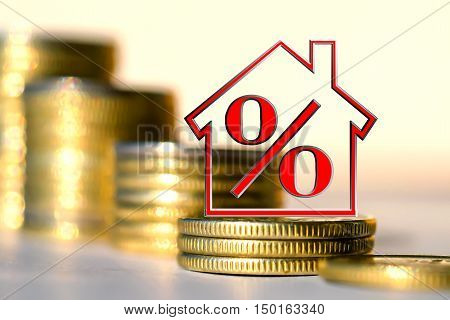 The percent symbol on a background of money . The concept of price changes on the real estate market .