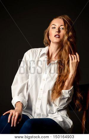 Beautiful young woman posing black background. Studio shot. Beauty, fashion concept.
