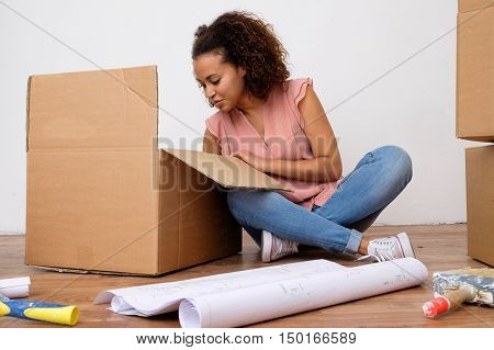 Young woman ready for the house renovation