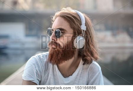 Bearded man wearing headphones