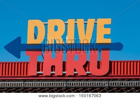 Colorful drive thru sign in red blue and yellow