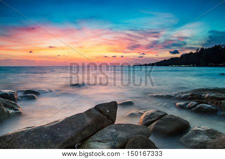 long exposure Beautiful seascape sunset or sunrise at the sea with stone on Beautiful cloud scape moody sky at Rayong Thailand