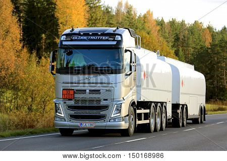 SALO, FINLAND - OCTOBER 2, 2016: New Volvo FH tank truck trucking along rural road in autumn. The ADR code 33-1203 signifies gasoline.