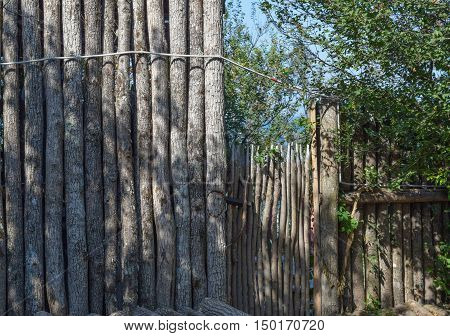 The Fence And Gate Made Of Logs