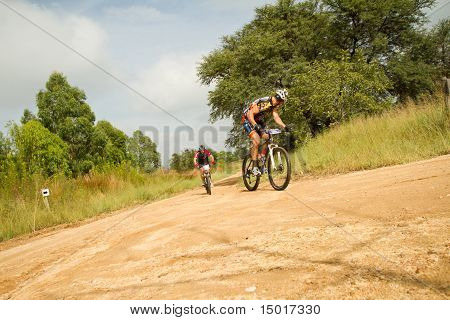 Mtb Rider Looking Back At Competitor