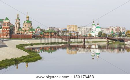 background panorama view of the waterfront of the city of Yoshkar-Ola, a puppet theater and the Twelve Apostles, Mari El, Russia