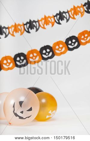 Halloween decoration with sacary balloons and pumpkins and paper bats.