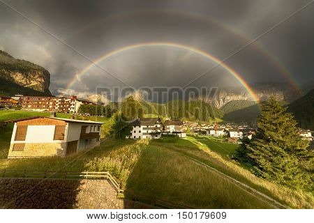 Rainbow after the thunderstorm over the Selva di Val Gardena in a summer end of the day Trentino-Alto Adige - Italy