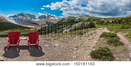 Panorama Pair of Red Chairs on the Trail Up to Wilcox Pass with Athabasca Glacier in the background
