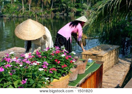 Flowers And Two Mekong Girls