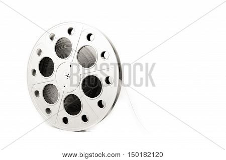 Big vintage cinema projector 35 mm movie reel with film black and white and isolated copy space on the right