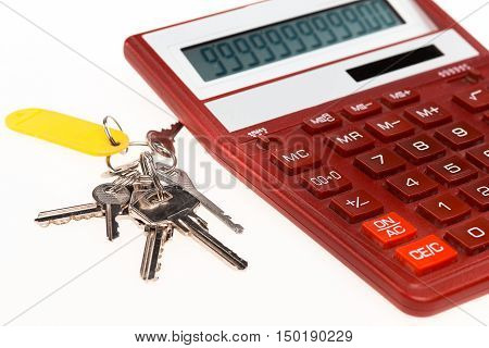 The red calculator with a keys on the white background