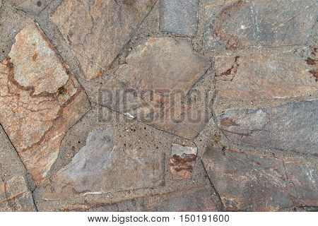the abstract textured background or wallpaper from a shapeless stone tile