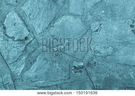 the abstract textured background or wallpaper of blue color from a shapeless stone tile