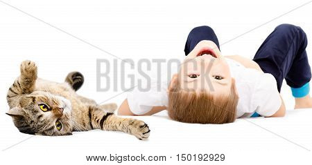 Portrait of a cheerful boy and cat Scottish Straight lying on its back isolated on white background