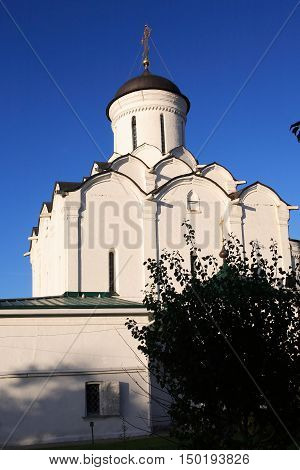View of nice ancient Russian monastery against blue sky city of Vladimir