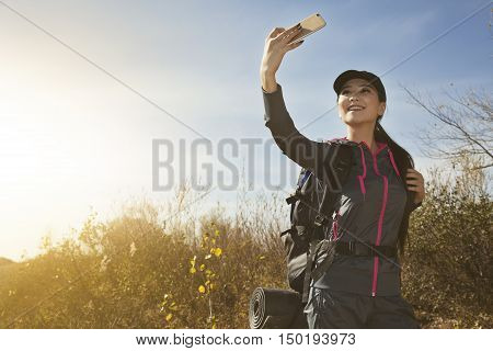 Torist Asian Young Woman With Her Mobile Phone