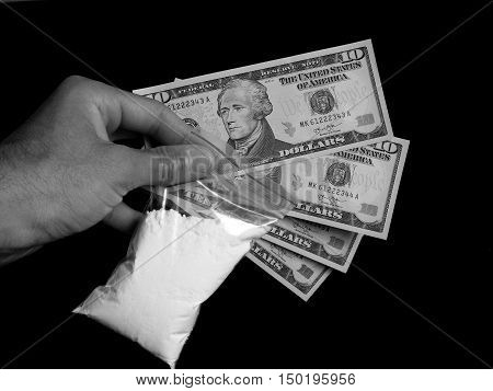 Men holding bag with cocaine drug powder and US money, dollar bills cash, men selling drugs junkie in black and white colors