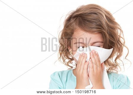 Young girl using tissue
