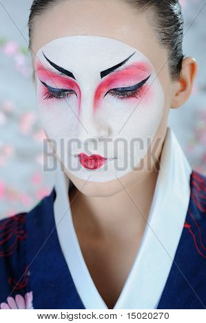 Japan Geisha Woman With Creative Make-up.close-up Artistic Portrait
