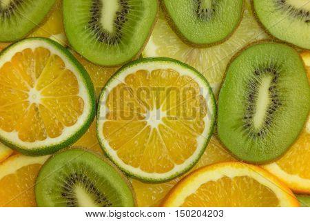 slices of kiwi, orange and sweetie closeup