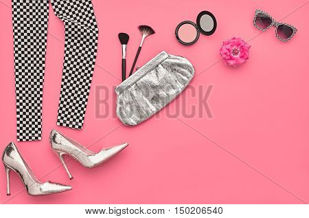 Fashion Design Outfit. Essentials fashion Cosmetic Makeup. Fashion woman Clothes Accessories Set. Minimal. Stylish Leggings, Glamor fashion Heels, Handbag Clutch, Trendy Sunglasses. Top view. Creative