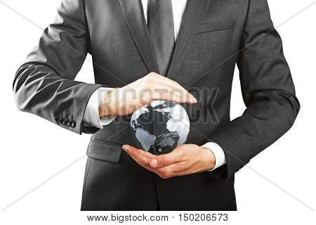 Closeup of businessman hands holding small terrestrial globe on white background. Eco friendly business and environment protection concept