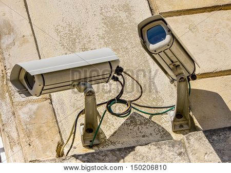 closeup on two security CCTV surveillance system in office building
