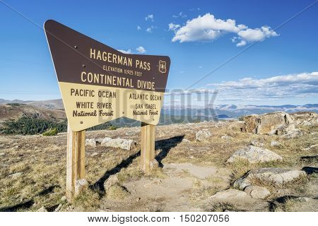 HAGERMAN  PASS, SEPTEMBER 27, 2016: US Forest Service sign at a summit of Hagerman Pass and continental divide in Colorado's Rocky Mountains.