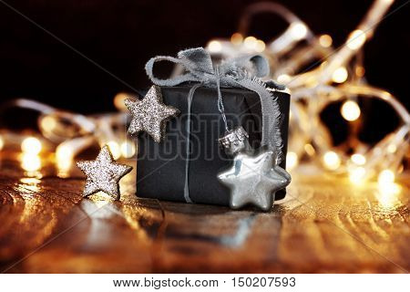 Christmas gift with silver stars and a string of lights