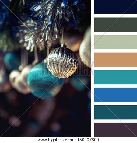 A garland of antique style Christmas tree baubles hanging from tinsel. In a colour palette with complimentary colour swatches.
