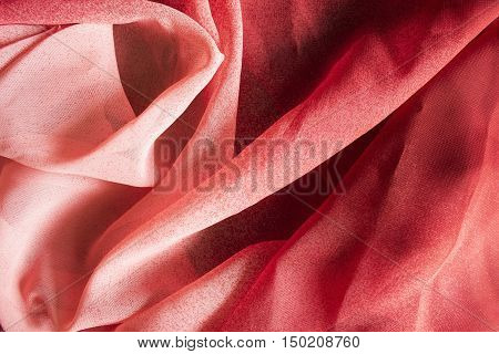 Abstract red draped silk closeup as a background