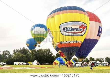 Ferrara Italy 16 September 2016 - many colorful hot air balloons take off and fly together at the Ferrara Balloons Festival 2016