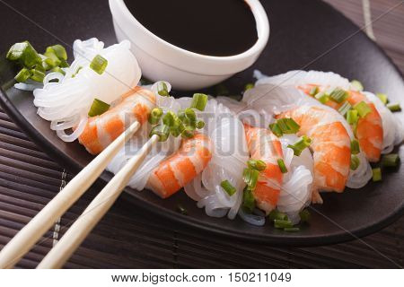 Shirataki Noodles With Shrimp And Green Onions Close-up. Horizontal