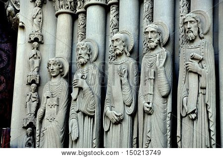 New York City - June16 2013: Elongated statues of the Apostles flank the central entrance portal at Riverside Church