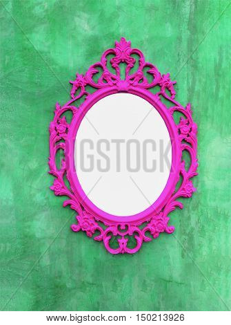 pink Picture frames or mirrors on the walls green