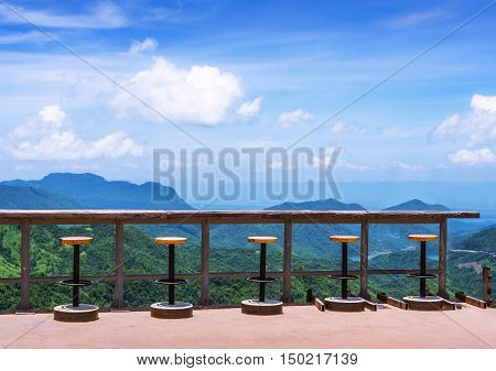 Counter and outdoor seating Among the mountains and clear blue sky.