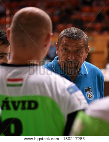 KAPOSVAR, HUNGARY - SEPTEMBER 30: Gyorgy Demeter (r) Kaposvar trainer in action at a Hungarian Championship volleyball game Kaposvar (green) vs. PEAC (white), September 30, 2016 in Kaposvar, Hungary.