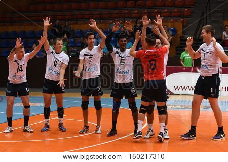 KAPOSVAR, HUNGARY - SEPTEMBER 30: PEAC players celebrate before a Hungarian National Championship volleyball game Kaposvar (green) vs. PEAC (white), September 30, 2016 in Kaposvar, Hungary.