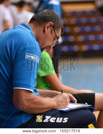 KAPOSVAR, HUNGARY - SEPTEMBER 30: Gyorgy Demeter Kaposvar trainer in action at a Hungarian Championship volleyball game Kaposvar (green) vs. PEAC (white), September 30, 2016 in Kaposvar, Hungary.