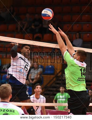 KAPOSVAR, HUNGARY - SEPTEMBER 30: Tamas Vajda (in green) in action at a Hungarian National Championship volleyball game Kaposvar (green) vs. PEAC (white), September 30, 2016 in Kaposvar, Hungary.